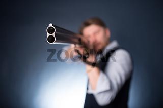 Manager holding a shotgun