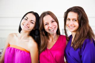 Three happy female teen girls