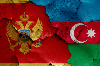 flags of Montenegro and Azerbaijan painted on cracked wall