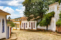 Street with cobblestones and some houses with colonial architecture