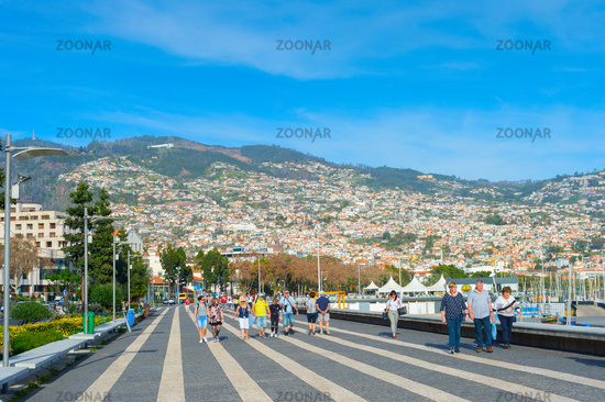 People walking embankment Funchal Madeira
