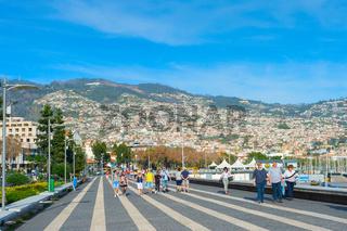 People walking embankment Funchal Madeira