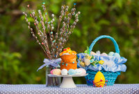 Easter cake, willow and painted eggs outdoors