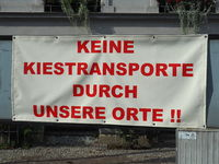 Protest sign against gravel transports