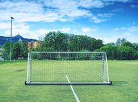 Football field with white marks, green grass in soccer field. Outdoor stadium