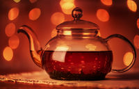 Glass teapot with  golden bokeh lights