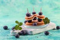 Trendy food - skewers with mini pancakes.