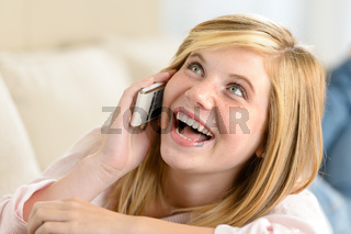 Cheerful teenage woman laughing calling on phone
