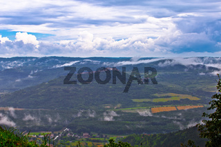 Istra. Green lanscape of Istria and hill town of Motovun fog view