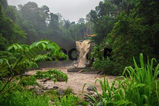 Muddy waters of a Tegenungan waterfall