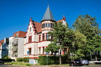Rostock, Germany - 07.06.2019 - city villa with roof tower
