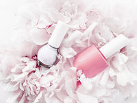 Nail polish bottles on floral background, french manicure and cosmetic branding