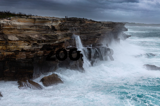Large swells batter the cliffs of Sydney