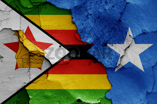 flags of Zimbabwe and Somalia painted on cracked wall