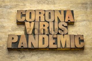 coronavirus pandemic word abstract in wood type