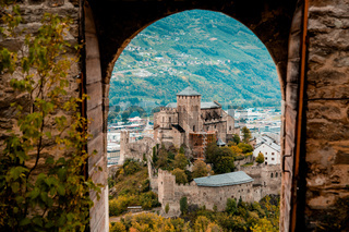 Medieval Valere basilica seen through main gates of Tourbillon Castle located in Sion city, canton Valais, Switzerland