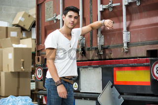 Young Man with Next to Cargo Truck