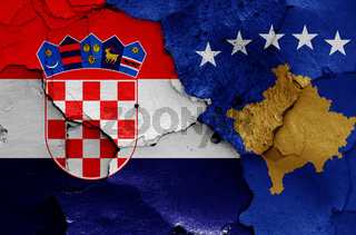 flags of Croatia and Kosovo painted on cracked wall