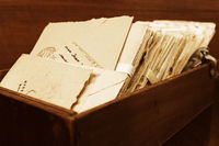 Old postal letters in a wooden box