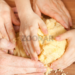 Many hands knead the dough