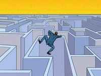 A businessman tries to pass a maze