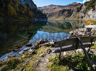 Sunny autumn alpine Tappenkarsee lake and rocky mountains above, Kleinarl, Land Salzburg, Austria.