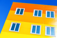 Bright colorful apartment building against blue sky