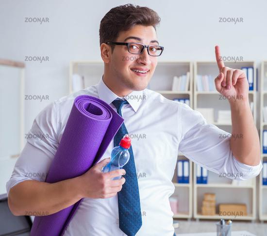 Businessman preparing to go exercising in gym