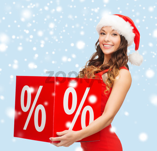 woman in santa helper hat with percent sign