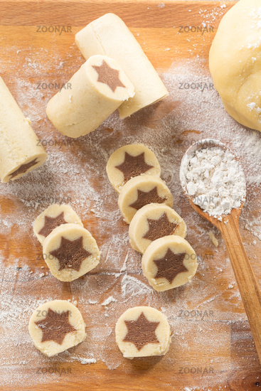 Baking christmas cookies with chocolate star.  Homemade bakery