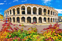 Roman amphitheatre Arena di Verona and Piazza Bra square autumn leaves view