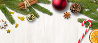 Christmas decorations on a wooden background with copy space