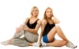 two young sporty women after intense workout