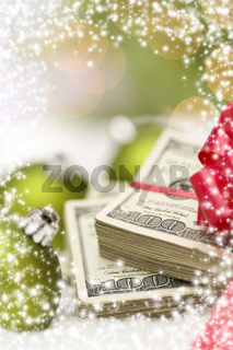 Stack of Hundred Dollar Bills with Bow Near Christmas Ornaments