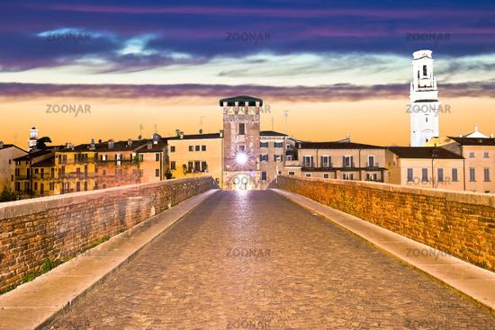 Ponte Pietra bridge and Verona waterfront architecture sunset view