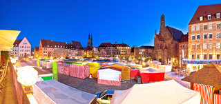 Nurnberg. Nuremberg main square and church of Our Lady or Frauenkirche dusk panoramic view