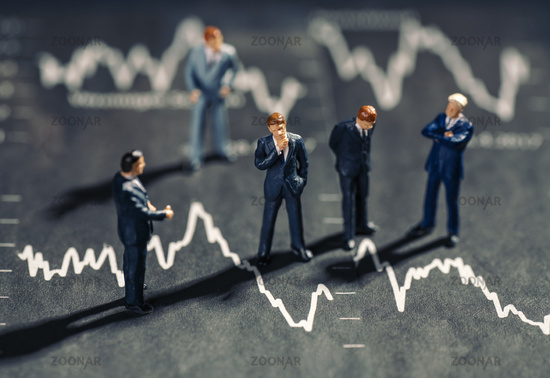 Businessmen and falling stock prices