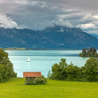 Dramatic clouds over lake Forggensee in Bavaria