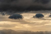 Beautiful dramatic clouds in sky during rain. Dramatic natural cloudiness weather background
