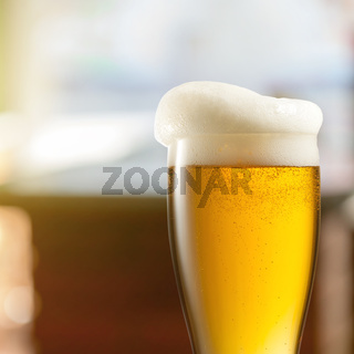 Glass of light beer in pub