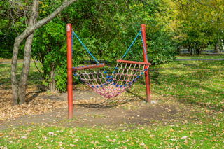 Empty wicker hammock in autumn park