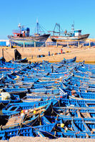 the blue fishing boats in the port of Essaouira Morocco