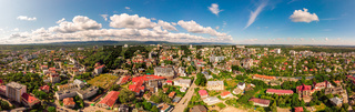 Truskavets, Ukraine - July 29, 2019: Birds eye view of Truskavets city, Ukraine. Popular healing spa resort with mineral springs. Aerial drone 180 degrees panoramic landscape