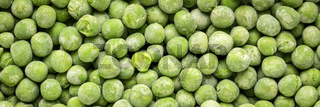 closeup background and texture of frozen green peas