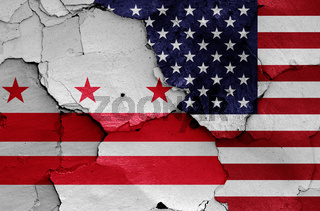 flags of Washington D.C. and USA painted on cracked wall