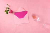 Greeting card, Valentine or invitation mockup, a flat lay with a pink rose