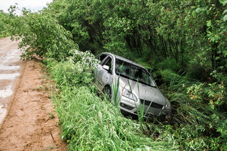 car drove off the road after rain into a pit