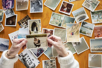 Top view of a senior caucasian woman looking at an old photos themes of memories nostalgia photos re