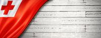 Tonga flag on old white wall banner