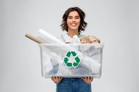 happy smiling young woman sorting paper waste